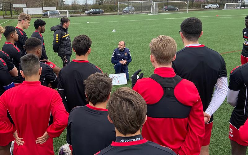 Coach Fran Constancio leads a team talk